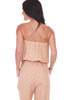 back shows billowing strapless top with elastic waistband and waist tie, side pockets and jumpsuit is in a blush and white polka dot pattern.