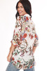 Back shows long sleeve embroidered multi floral patterned applique shirt.