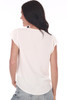 Back shows white blouse M.Fredric Collection with chiffon material. Shown worn with light blue jeans.