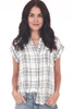 Front shows short sleeve blouse featuring a button up front with left breast pocket, super soft white and blue plaid material, stripe up sides. Shown paired with light blue jeans.