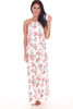 Front shows long white halter dress with allover floral plant design a top ruffle, adjustable halter top and long maxi skirt.