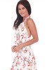 Side shows long white halter dress with allover floral plant design a top ruffle, adjustable halter top and long maxi skirt.