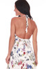 front shows fully lined vanilla and floral maxi dress with adjustable halter top straps and open back.