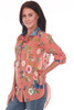 front shows orange button up top with velvet collar with embroidered flowers all over, long sleeves and a hi-lo bottom hemline.