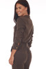 Back shows olive green long sleeve jumpsuit with soft tencel-blend material with snap button closure, waist tie.