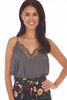 Front shows dark grey colored cami top with lace trim v shape neck line and lace bottom, very thin spaghetti straps and a flowy silk-like material.