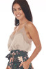 side shows beige colored cami top with lace trim v shape neck line and lace bottom, very thin spaghetti straps and a flowy silk-like material.