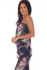 Side shows navy blue tube top jumpsuit with all over palm tree design, an elastic band at top, drop-waist line, and stretchy material.