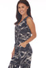 Side shows black and white slash marks design ankle length jumpsuit with a surplice front neckline with snap closure, elastic waistband with tie  and two side pockets.