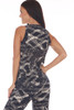 Back shows black and white slash marks design ankle length jumpsuit with a surplice front neckline with snap closure, elastic waistband with tie.
