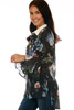side shows  long sleeve black blouse featuring a velvet color, button up front, white collars, super wide bell sleeves & all over colorful flower appliques.