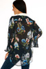 back shows  long sleeve black blouse featuring a velvet color,long bottom, white  nack collar, super wide bell sleeves & all over colorful flower appliques.