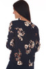 Back shows long sleeve blouse, tie at front bottom & all over fall floral print.