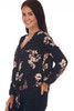 Side shows long sleeve blouse with a v-neck line, tie at front bottom & all over fall floral print.