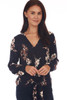 Front shows long sleeve blouse with a v-neck line, tie at front bottom & all over fall floral print.