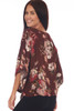 Back shows red wine colored loose fit kimono-like sleeved blouse with an all-over fall floral print.
