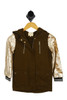 front shows long sleeve olive jacket featuring a classic military jacket style with gold embellishments, champagne-colored sequin sleeves, zip up front 2 pockets, and black & white striped detailing at wrist cuffs.