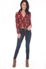 front shows skinny blue Jeans featuring a mid rise with a soft & stretchy material and super skinny tapered leg. shown warn with brown boots and red flowered blouse.
