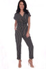 front shows black striped short sleeve jumpsuit featuring a twist front with deep v-neck line, elastic band at waist and tapered skinny legs.