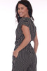 back shows black striped short sleeve jumpsuit featuring a twist front with deep v-neck line, elastic band at waist and tapered skinny legs.