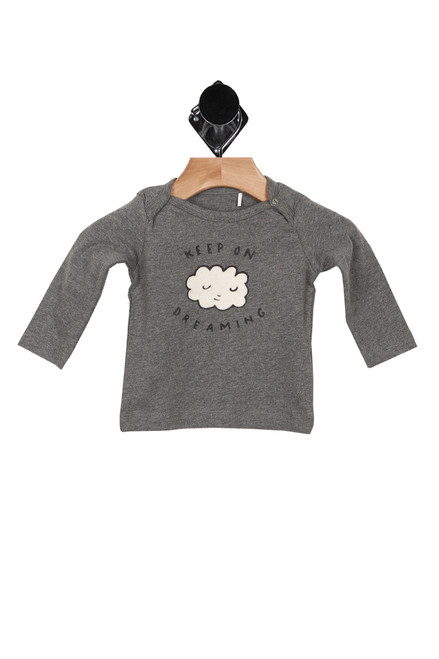 "grey long sleeve, button snaps on top of both shoulders graphic shows smiley face on white cloud and ""keep on dreaming"" written in black"
