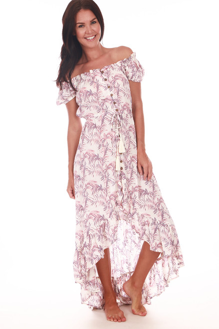 front shows cream and pink palm tree patterned dress with an elastic top band for a comfortable fit with drawstring at waist and button down skirt and off shoulder ruffled sleeves. The front has a much higher hemline then back and it features a ruffle detail.