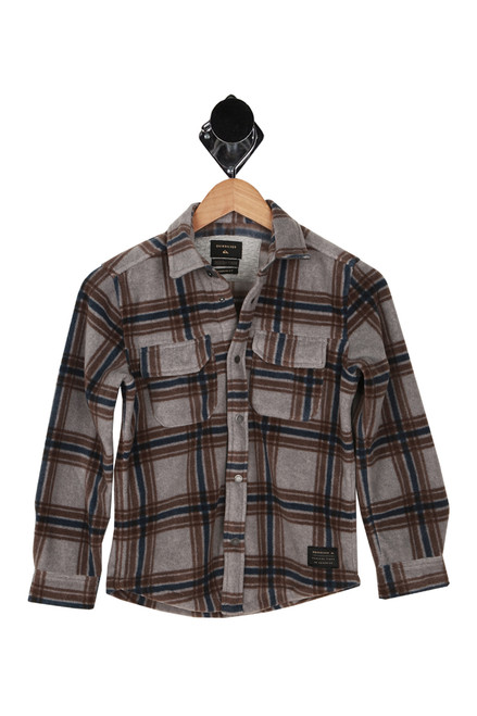 Front shows grey, blue and brown long sleeve flannel featuring two front pockets and cuffed sleeves.