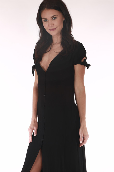 front shows black maxi featuring tied short sleeves with button up front & front slit.