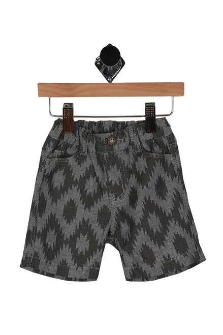 front shows grey shorts with tribal print all over, elastic band, and faux snap front.