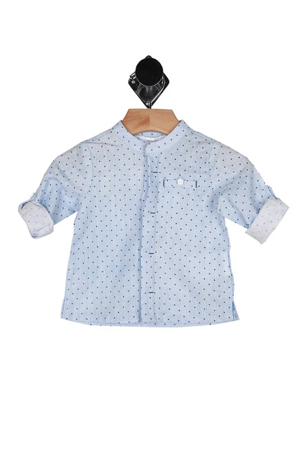 front shows light blue and polka dot button up shirt with pocket at left side with hidden button up front and rolled sleeves.