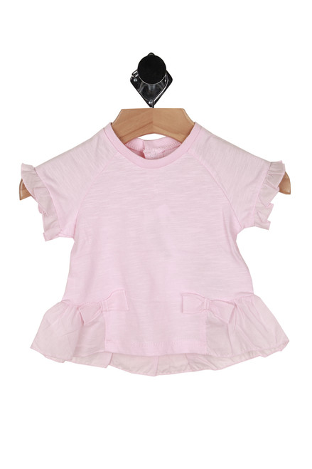 Front shows light pink ruffle tee with ruffled hemlines with 2 front bows.