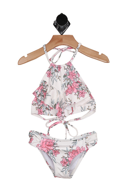 Front shows two piece white bathing suit with pink and baby blue floral pattern all over. Halter top high neck tie and matching bottoms.