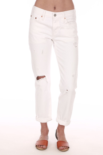 Front shows distressed white jeans with wider rolled up ankle length bottoms 2 front pockets.