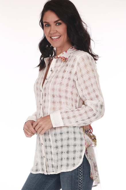 Side shows sheer white button up blouse  with checker pattern.