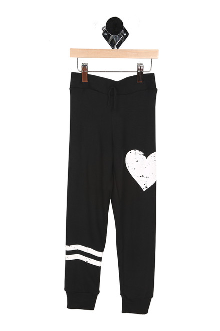 Front shows black sweats with two white stripes on bottom left leg and white heart on top left pant leg.