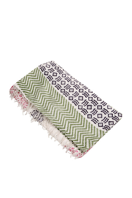 Top shows multi colored Chevron & Stripe printed tassel towel.