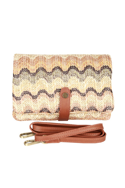 Front shows multi color and designed woven fold over cross body clutch bag with removable strap and leather snap.