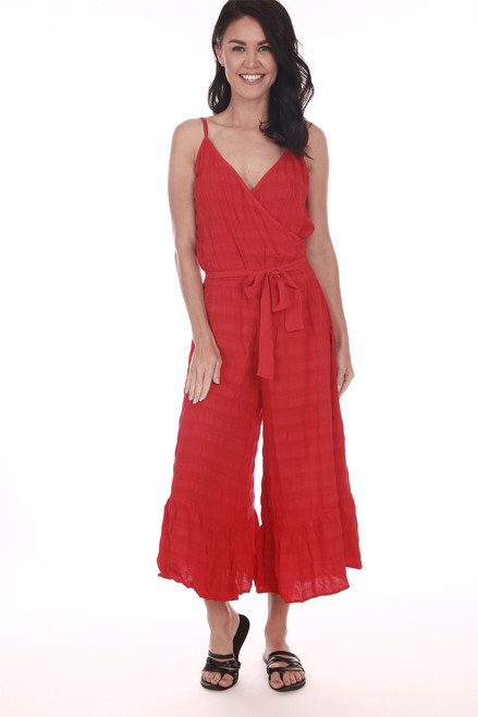 Front shows red wide flare leg cropped jumpsuit with spaghetti straps, v-shape neckline, and waste tie.  Shown worn with sandals.