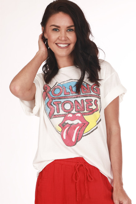"""Front shows white """"Rolling Stones"""" graphic design tee with tongue out.  Shown worn with red pants and sandals."""