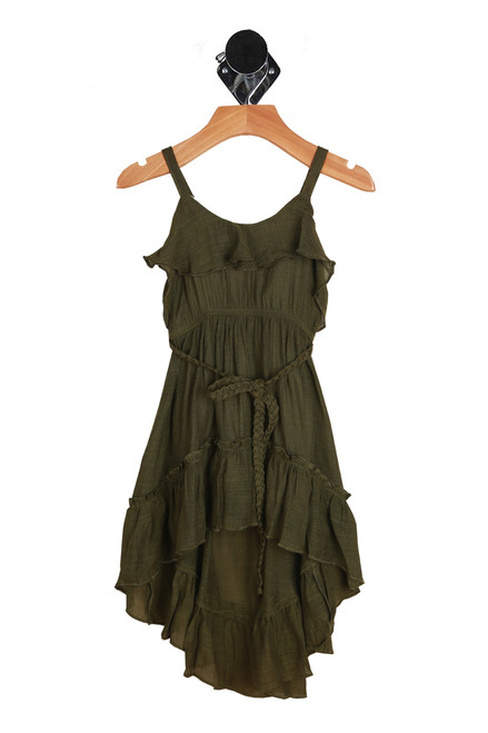 Front shows olive colored short dress with spaghetti straps with ruffle flap detail at top, elastic band at waist, matching braided belt and high lo bottom hemline.