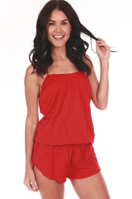 Front show red drop waist shorts romper with spaghetti strap halter top.