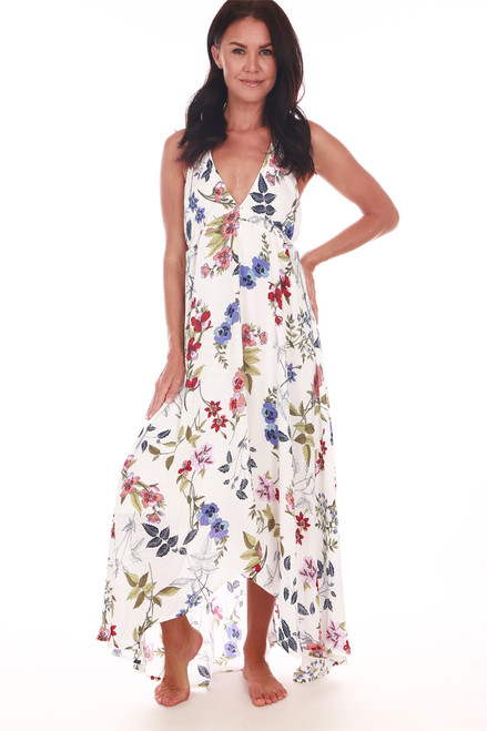front shows fully lined vanilla and floral maxi dress with adjustable halter top straps, v shape neckline and open back.