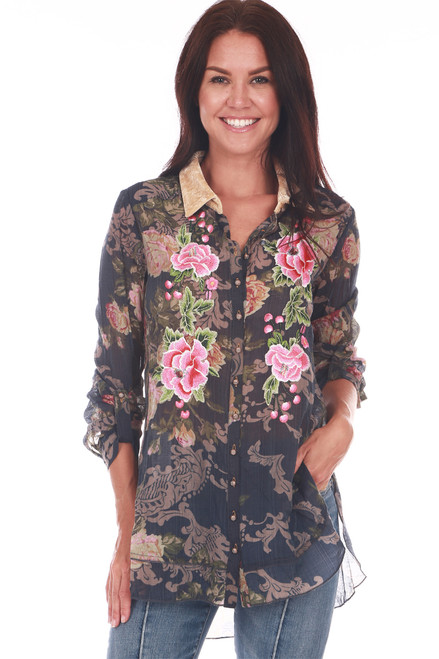 front shows sheer dark blue button up top with velvet collar with floral all-over print, long sleeves and pink floral applique at front. Bottom hem is hi-lo