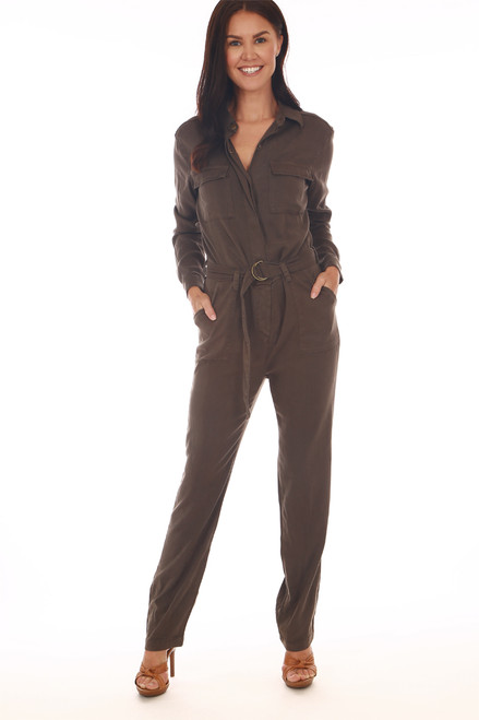 Front shows olive green long sleeve jumpsuit with soft tencel-blend material with snap button closure, waist tie & skinny bottom leg. Shown worn with orange open toe heels.
