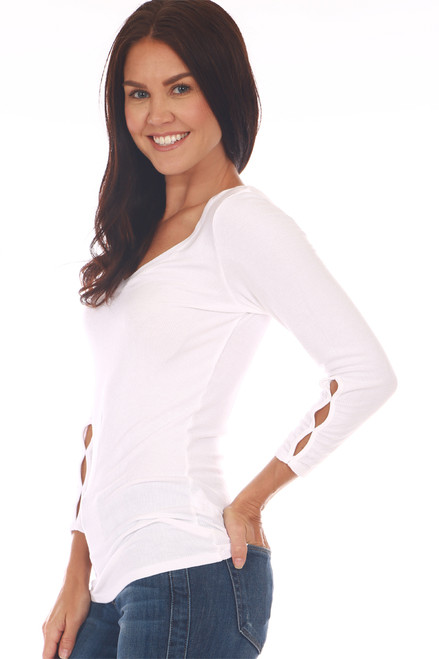Side shows white top with 3/4 sleeve length & a wonderful rib-knit material, v-neckline with cut-outs at bottom arm. Shown worn with blue jeans.