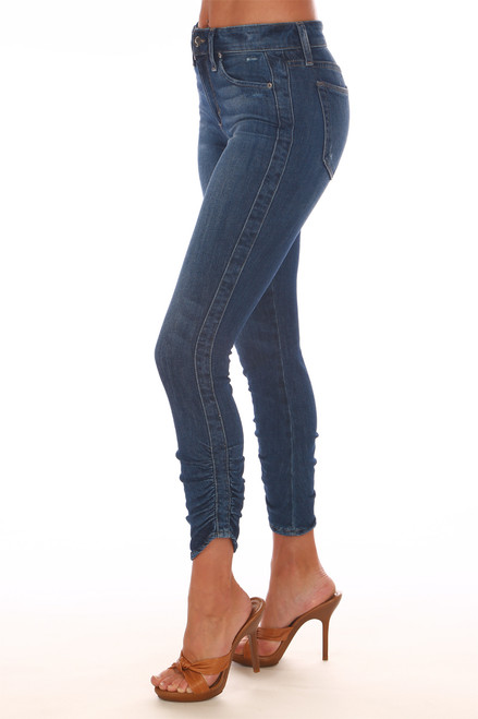 Side shows ankle skinny jeans with mid-rise, button-fly front closure, gathered bottom hemlines and the perfect lighter denim color. Shown worn with orange open toe heels.