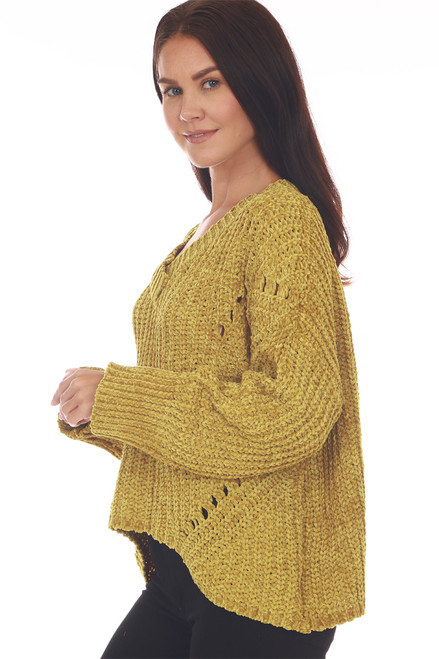 Side shows mustard colored long sleeve sweater featuring a super soft chenille material with wider fit and slightly cropped bottom hemline.
