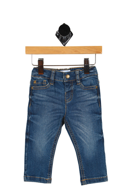 Front shows blue super stretchy denim trouser jeans with snap closure at front with slim fit bottom, and 3 front pockets.