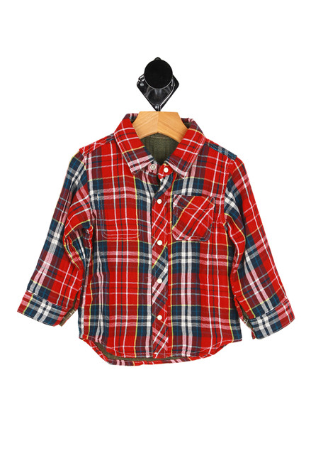 front shows red flannel long sleeve shirt featuring a snap down front with super soft cotton material and a 2-in-1 look with a reversible green shirt inside.