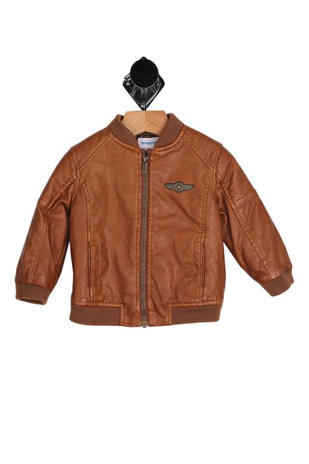 front shows long sleeve pilot-styled brown faux leather jacket featuring a classic pilot style with patch detailing, front pockets & zipper closure at front.